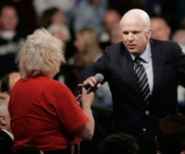 Presidential candidate John McCain takes the microphone from a woman who says opponent Barack Obama is 'an Arab.'