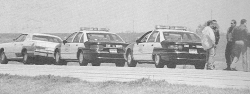 Timothy McVeigh's Mercury Marquis and two Oklahoma state trooper vehicles, in a photo taken shortly after McVeigh was pulled over for not having a license plate.