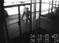 Security camera footage of the Ryder truck used by Timothy McVeigh to deliver the bomb as it is parked in front of the Murrah Federal Building just minutes before detonation. The truck is barely visible in the upper left of the frame.