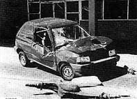 The rear axle of the Ryder truck from the bombing (foreground), used by the FBI to identify the truck and discover the identity of the bomber. The axle was blown 575 feet and crushed the Ford Festiva depicted in the photo.