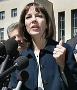 Judith Miller speaks to reporters outside the courtroom.