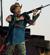 Rock musician Ted Nugent, brandishing an assault rifle on stage in this undated photo. It is not clear whether the rifle is real.