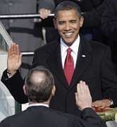President-elect Barack Obama takes the oath of office as administered by Chief Justice John Roberts. His wife Michelle holds the Bible used to administer the oath, which will be redone the second day because of a minor error in Roberts&#8217;s delivery.
