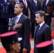 US President Barack Obama and French President Nicolas Sarkozy review French troops during Obama's 2009 visit to Strasburg.