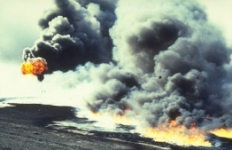 Oil spilled into the Persian Gulf is set afire.