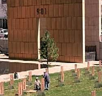 Workers put the finishing touches on the Oklahoma City National Memorial. The time of the bombing, &#8216;9:01,&#8217; is inscribed on the side of the memorial.