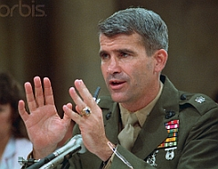 Oliver North testifying before the Iran-Contra Committee.