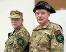 A 2009 photo of Ray Southwell and Norm Olsen. Both are wearing Alaska militia emblems.