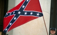 A protester holds a Confederate battle flag during a tea party rally in Olympia, Washington.