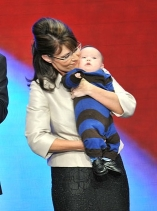 Sarah Palin holds her youngest child, Trig, for the cameras.