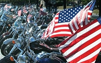 Members of the Patriot Guard Riders block Westboro Baptist Church protesters from the view of memorial proceedings in Joplin, Missouri.