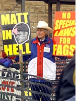 The Reverend Fred Phelps, holding a sign outside Matthew Shepard's funeral service.