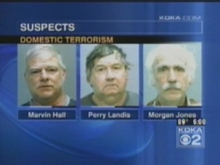 A screenshot of a local Pittsburgh news broadcast showing three of four suspects arrested on charges of domestic terrorism.