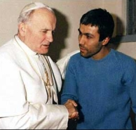 Pope John Paul II visits his would-be assassin, Mehmet Ali Agca, in prison, in 1983.