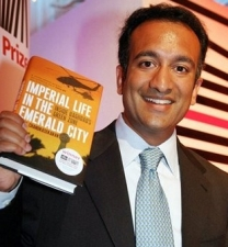 Author Rajiv Chandrasekaran, holding a copy of his 2006 book, &#8216;Imperial Life in the Emerald City.&#8217;
