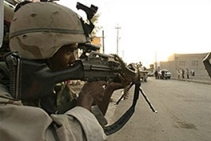 A scene of a US soldier aiming his weapon from the 'Ramadi Madness' videotapes.