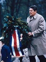 President Reagan places a wreath on a grave at Bitberg Cemetery.