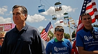 Presidential candidate Mitt Romney (R-MA) visits the Iowa State Fair. He is flanked by several campaign volunteers.