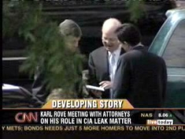 Karl Rove discusses his testimony with his lawyers outside the grand jury chambers.