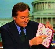 A screenshot from NBC News's November 19, 2000 'Meet the Press' broadcast, featuring Tim Russert using a whiteboard to illustrate electoral vote tallies.