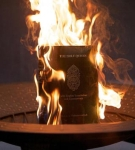 A Koran burns in a firepit after being set alight by Reverend Wayne Sapp of the Dove World Outreach Center in Gainesville, Florida.