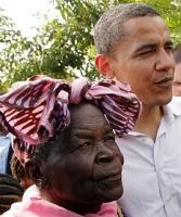 Sarah Obama, standing with her step-grandson Barack Obama in a 2009 photograph.