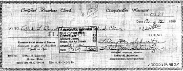 An image of a fraudulent 'Freeman check' signed by LeRoy Schweitzer.