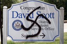 A swastika painted by an unknown party on the office sign of a Democratic supporter of health care reform. 