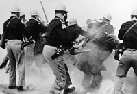 Alabama police attack civil rights marchers on the Edmund Pettus Bridge outside of Selma, Alabama.