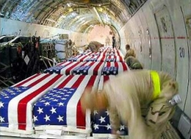 One of Tami Silicio&#8217;s photos of flag-draped coffins on a transport plane in Kuwait.