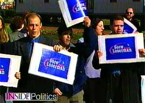 Bush supporters display 'Sore Loserman' signs.