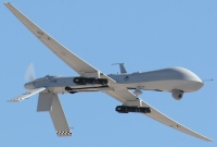 Joseph Farah claims his house was &#8220;buzzed&#8221; by a spy drone similar to this US Predator drone flown in Afghanistan. It is not clear if the drone Farah claims to have seen was armed with wing-mounted missiles, as this one is.