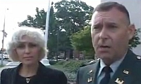 Lawyer Orly Taitz (left) and Army Reserve Major Stefan Cook, during an interview for a television news crew.
