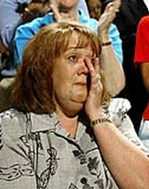 Tammy Pruett weeps while watching Bush's presentation.