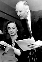 Senator Strom Thurmond (right) supervises the typing of an early draft of the document that will come to be known as the &#8216;Southern Manifesto.&#8217;