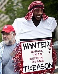 A sign displayed at a tea party protest depicting President Obama as a Muslim and a traitor.