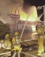 Firefighters battle a blaze at a Tucson McDonald's restaurant.