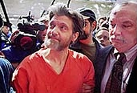 Theodore &#8216;Ted&#8217; Kaczynski, accused of killing two people and injuring 29 as part of the &#8216;Unabomber&#8217; crime spree, shown shortly after his arrest. He is wearing the orange prison garb issued to him by Montana authorities.