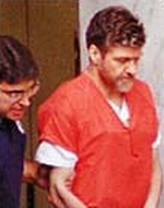 Theodore 'Ted' Kaczynski, convicted of charges stemming from the 'Unabomber' serial bombing spree, is escorted into the courtroom to hear his sentence.