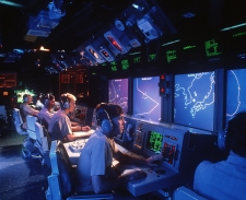 Crew members monitor radar screens in the combat information center aboard the <i>Vincennes.</i> This photo was taken by a crew member in January 1988.