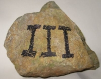 Photo of a rock included on his blog post by Mike Vanderboegh. The meaning of the Roman numeral III is unclear.