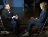 Tim Wise (L) and Laura Flanders during their interview.