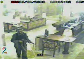 An armed attacker in the lobby of the Serena Hotel in Kabul, Afghanistan, on January 14, 2008.