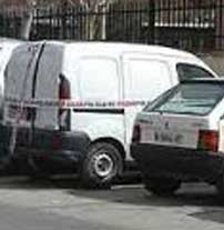 The white van, impounded in a police parking lot.