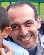 Bisher al-Rawi holding a child after release.
