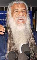 Jamil al-Banna speaking to the press after returning to Britain.