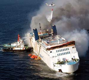 Firefighters around the Superferry 14.