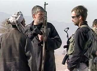 "CIA officer ""Dave"" (center) and US special forces near Qala-i-Janghi fortress."
