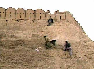 The Northern Alliance assaults Qala-i-Janghi fortress.