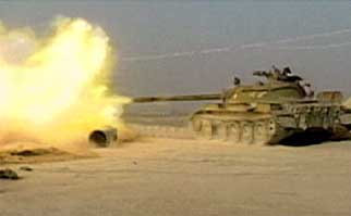 A Northern Alliance tank fires on Qala-i-Janghi fortress.